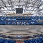 die Einsamkeit ist spürbar in einer vollkommen menschenleeren Veltins - Arena in Gelsenkirchen