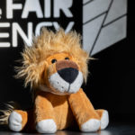 Leopold - der Löwe von Bayern International vor dem Logo von The Fair Agency